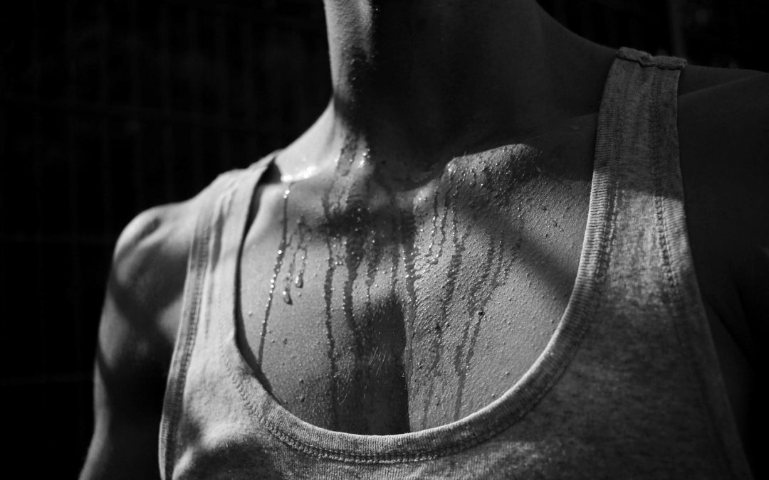 woman sweating after workout